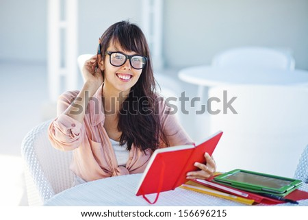 female student in interior of collage - stock photo