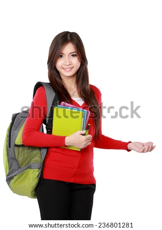female student in red cardigan presenting blank area copy space - isolated on white background. - stock photo