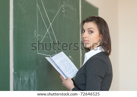 Female student is responsible with the synopsis near the boards in the University Auditorium - stock photo