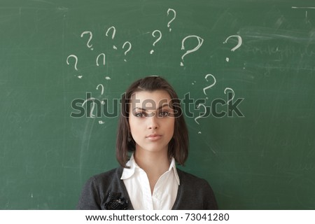 Female student of the board expressed surprise - stock photo