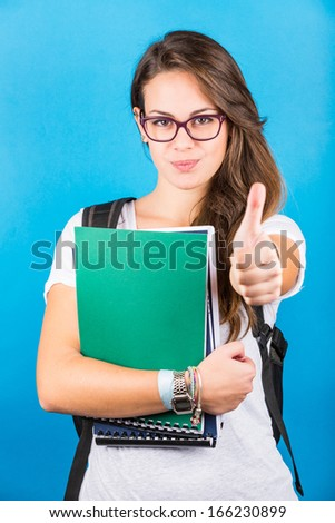 Female Student Portrait with Thumbs Up - stock photo