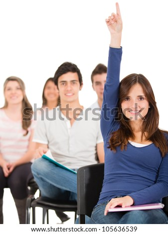 Female student raising her hand to ask a question - stock photo
