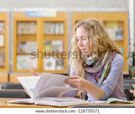 female student read book  in library.