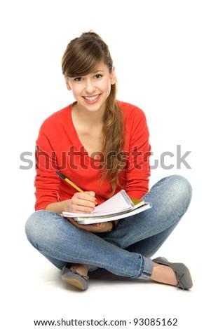 Female student sitting - stock photo