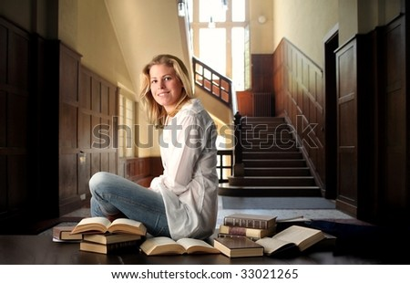female student studying in an old school - stock photo