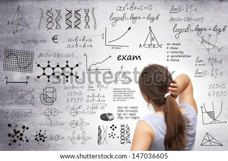 female student upset about assignment in class with written board - stock photo