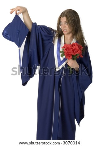Female student wearing grad gown with reluctant facial expression