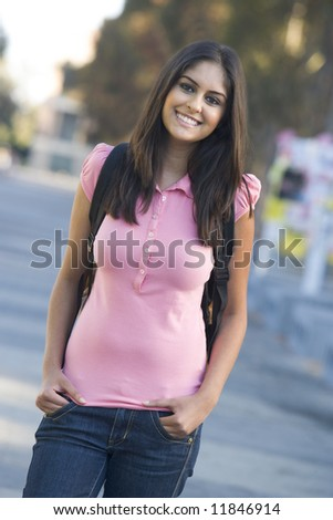 Female student wearing rucksack off campus - stock photo