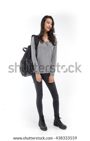 Female student with a backpack smiling on white background - stock photo
