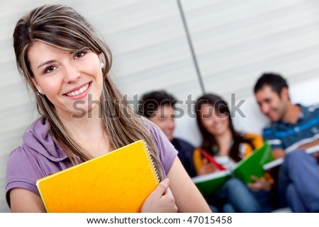 Female student with a group behind isolated over a white background