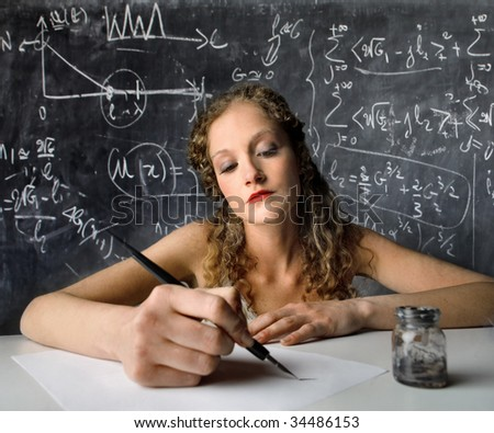 female student writing with ink pen - stock photo