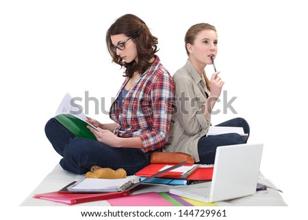 female students cramming for exam