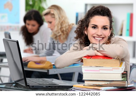 Female students in class - stock photo