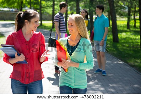 Female students outdoors with friends