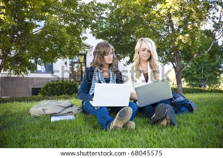 Female students studying on Laptop computers - stock photo