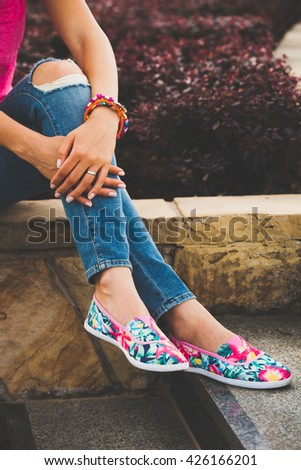female summer fashion details colorful bracelets and espadrilles