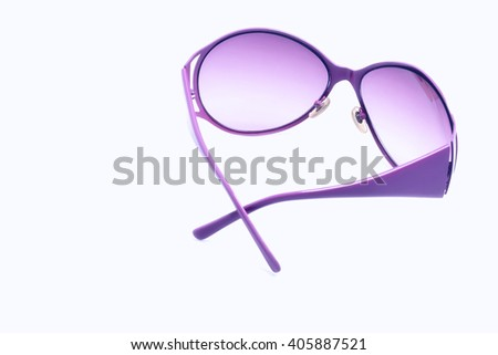 Female sunglasses on white isolated background, pink fashion glamorous sunglasses for the eyes - stock photo