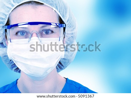 female surgeon in a hospital in blue tones