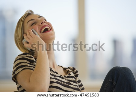 female talking on cell phone and laughing - stock photo