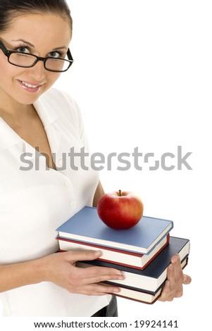 Female teacher holding books - stock photo