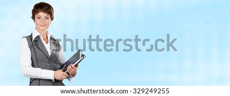 Female teacher or businesswoman holding a books on abstract blue background for banners or website headers