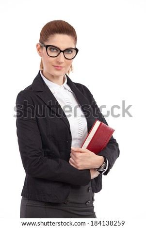 Female teacher posing. Elegance woman holding a notebook. Waist up studio shot isolated on white. - stock photo