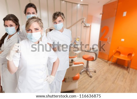 Female team of dental workers at the cabinet - stock photo