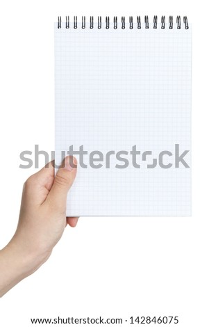 female teen hand holding notebook on a spring to write something, isolated - stock photo