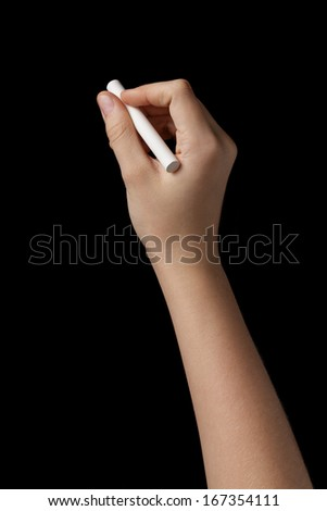 female teen hand with chalk to write something, isolated on black - stock photo