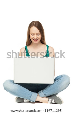Female teenager using laptop