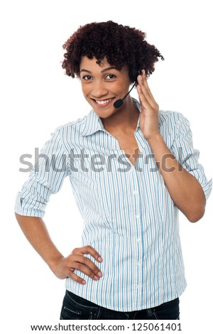 Female telemarketer wearing headset with mic.