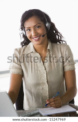 Female telesales worker in office - stock photo