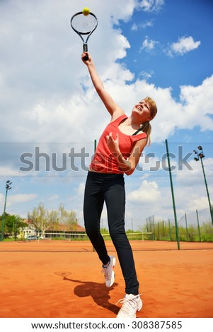 Female tennis player in a action,Shallow doff
