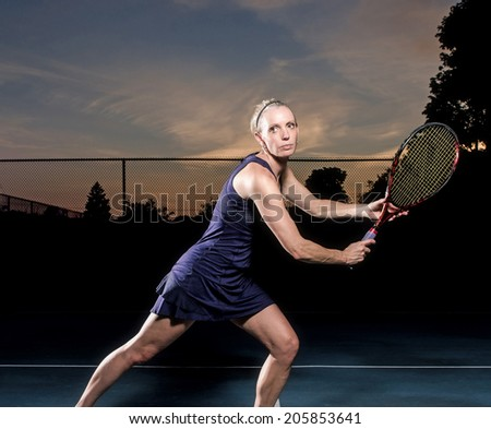 Female tennis player ready - stock photo