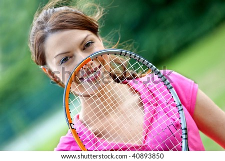 Female tennis player with a racket outdoors - stock photo