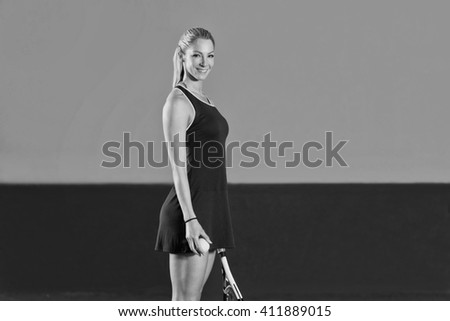 Female Tennis Player With Racket Ready To Hit A Tennis Ball - stock photo