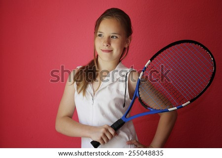 Female tennis player with racket ready to hit a tennis ball. Bright image over pink background. - stock photo