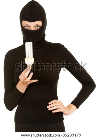 female thief in balaclava and light bulb - stock photo