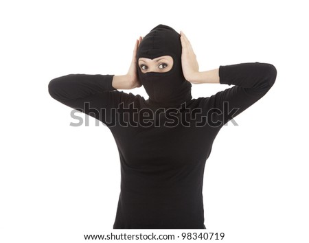 female thief in black balaclava and mask covering ears, white background - stock photo