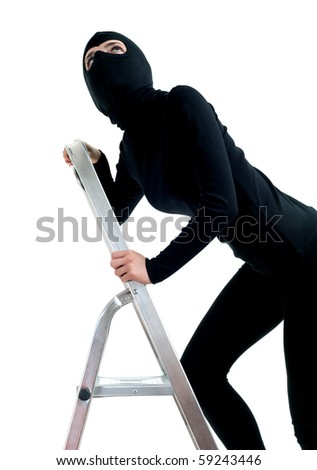 female thief in black balaclava entering on ladder, isolated - stock photo