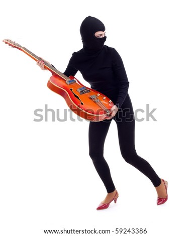 female thief in black balaclava with electric guitar - stock photo