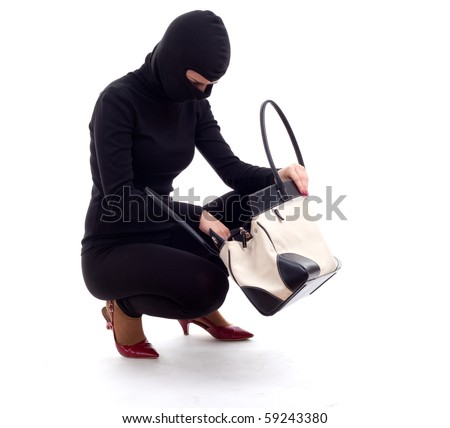 female thief in black balaclava with stolen bag - stock photo