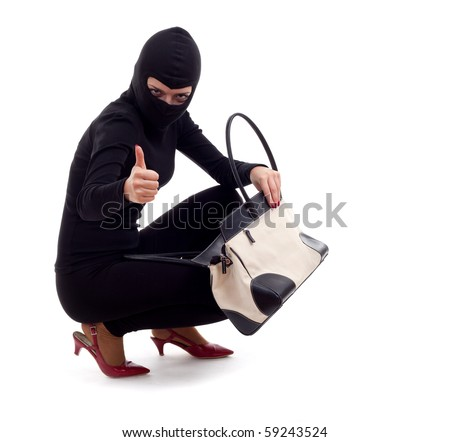 female thief in black balaclava with stolen bag, thumb up - stock photo