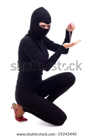 female thief in black clothes and balaclava keeping bracelet