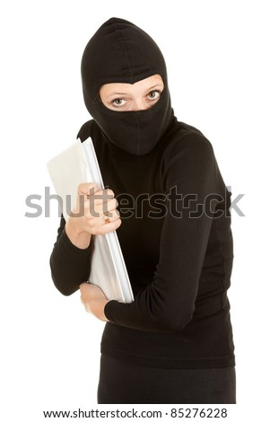 female thief in black clothes and balaclava steal documents - stock photo