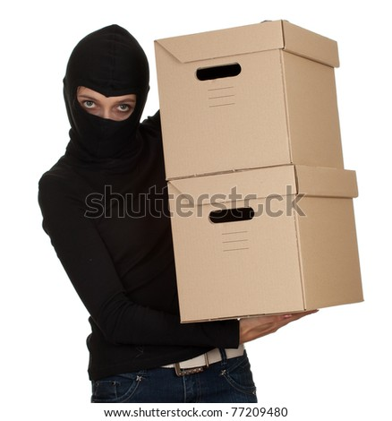 female thief in black clothes and balaclava with boxes - stock photo