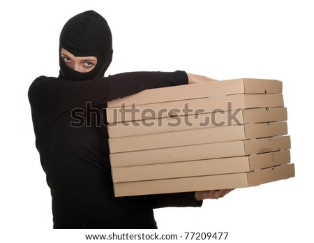 female thief in black clothes and balaclava with boxes of pizza - stock photo