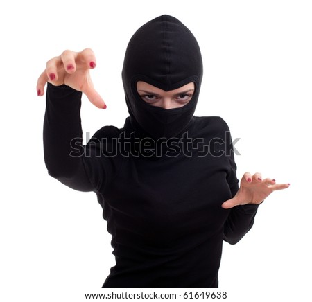 female thief in black clothes and balaclava with raised arm