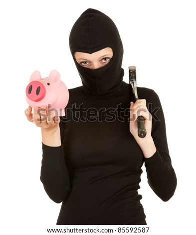 female thief with hammer trying broke piggy bank - stock photo