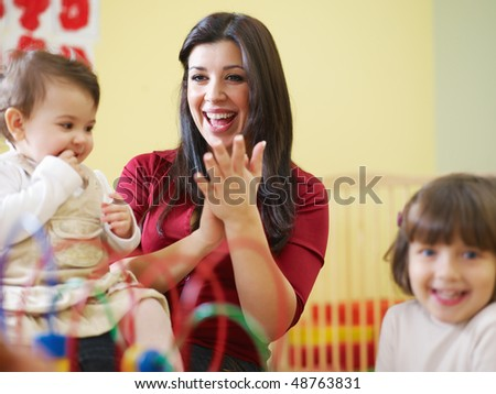 female toddler and 2-3 years girl playing in kindergarten. Horizontal shape, copy space - stock photo